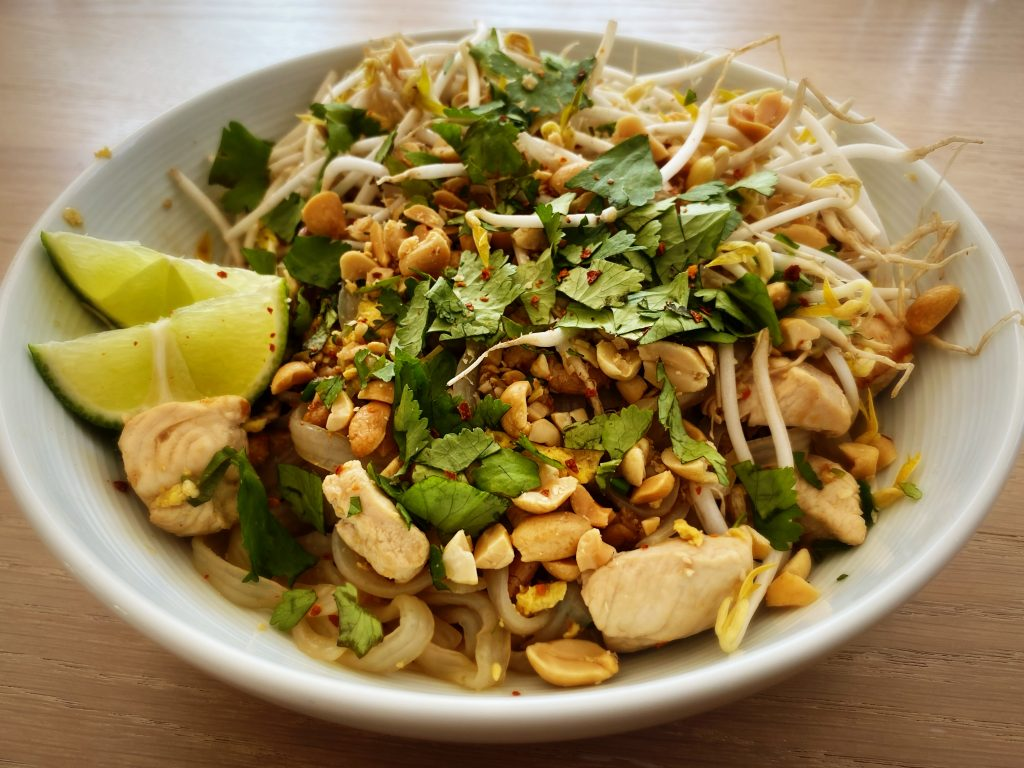 white bowl with ketogenic pad thai on a table